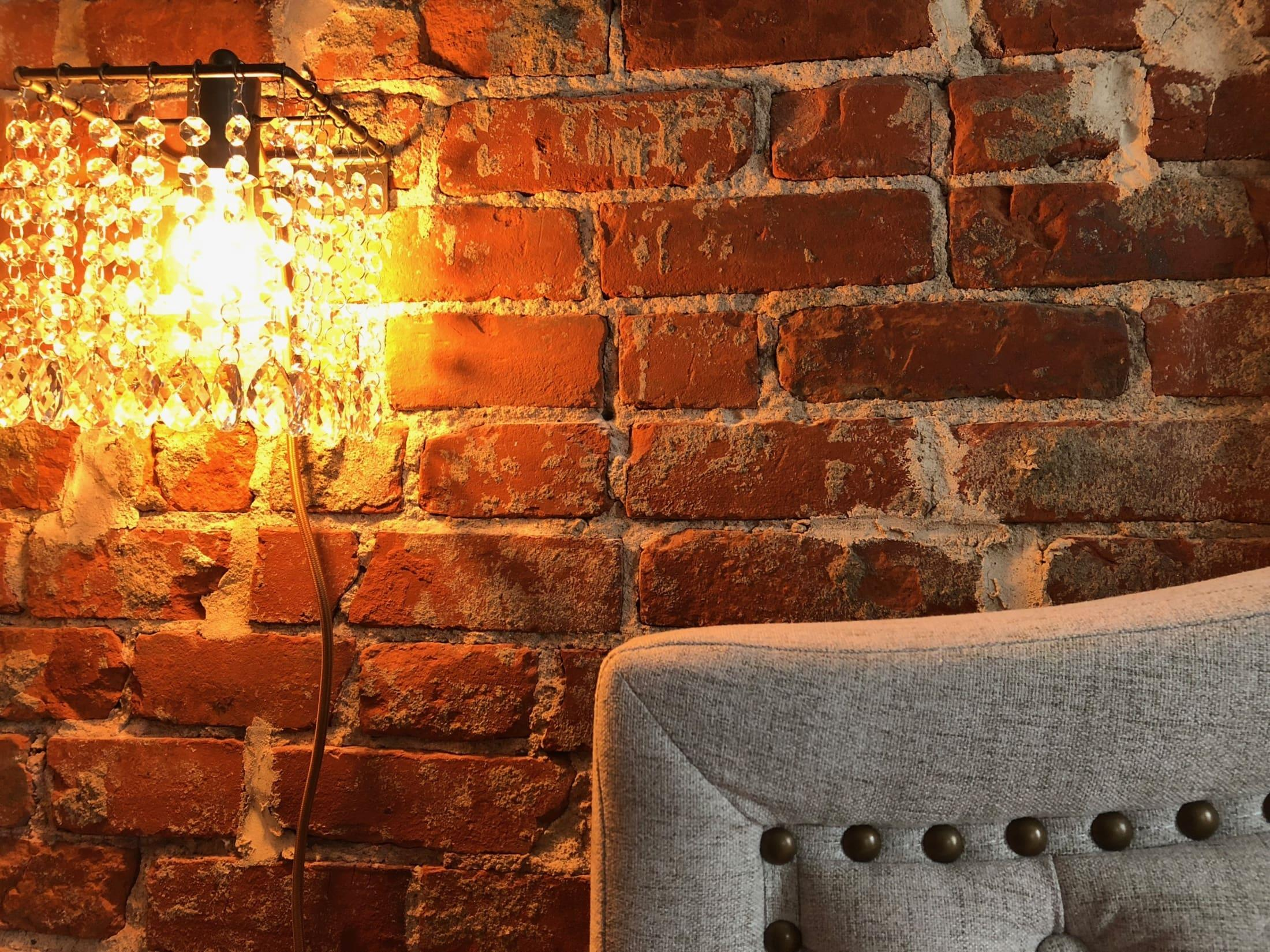 square-crystal-chandelier-on-brick-wall.jpg